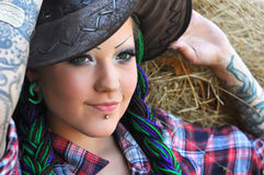 Young tattooed  stylish woman in cowgirl style Royalty Free Stock Photography