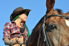 Young tattooed stylish woman riding in summer day Royalty Free Stock Photos