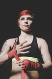 Young tattooed woman boxer close up portrait Royalty Free Stock Photography