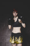 Young tattooed woman boxer close up Royalty Free Stock Image