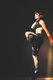 young tattooed woman boxer jumping close up Royalty Free Stock Image
