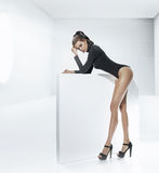 Young tawny woman with tempting legs Stock Photos