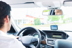 Young Taxi driver driving his car Stock Photography