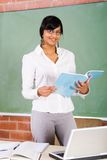 Young teacher. Young female teacher in classroom Stock Image