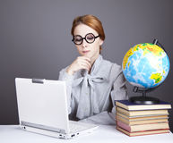 The young teacher with books, globe and notebook. Stock Photos