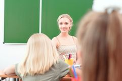 Young teacher in the classroom Royalty Free Stock Image