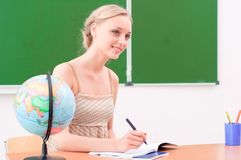 Young teacher in the classroom Stock Photos