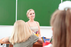 Young teacher in the classroom Stock Images
