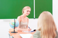 Young teacher in the classroom Royalty Free Stock Images