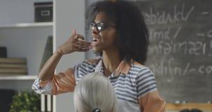 Young teacher explaining to a class stock photo