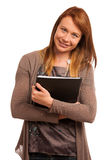 Young teacher with folder in her hands Royalty Free Stock Photo