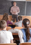 Young teacher in front of class Royalty Free Stock Photos