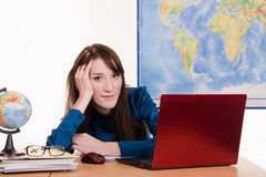 Young teacher of geography has earned for laptop Royalty Free Stock Photo