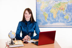 Young teacher of geography at the table Stock Photos