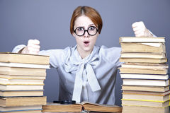 The young teacher in glasses with books. Royalty Free Stock Photo
