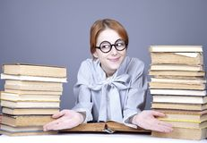 The young teacher in glasses with books. Stock Photos