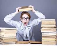 The young teacher in glasses with books. Royalty Free Stock Image