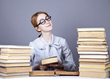 The young teacher in glasses with books. Royalty Free Stock Images