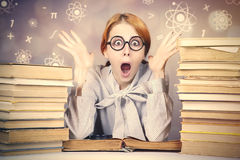 The young teacher in glasses with books. Stock Photo