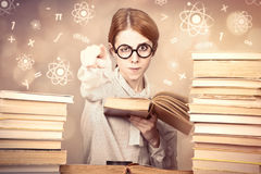 The young teacher in glasses with books. Stock Photography