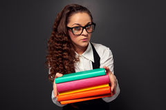 Young teacher in glasses offering books Stock Photos