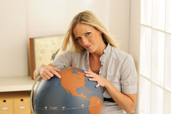 Young Teacher At Globe Royalty Free Stock Photos