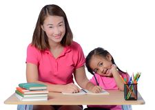 Young Teacher helping child with writing lesson isolated on white background royalty free stock image