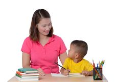 Young Teacher helping child with writing lesson isolated on white background stock photos