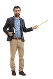 Young teacher holding a book and a wand Royalty Free Stock Photos