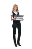 A young teacher is holding a stack of books Royalty Free Stock Photos