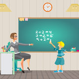 Young teacher holds a lesson in arithmetic in primary school. Bo Stock Photography