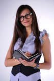Young teacher. With a notebook in hand Stock Photo