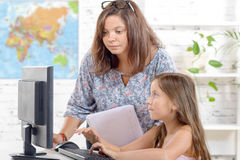 A young teacher and schoolgirl Stock Photo