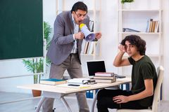 The young teacher and student in the classroom. Young teacher and student in the classroom royalty free stock photo