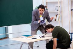 The young teacher and student in the classroom. Young teacher and student in the classroom stock image