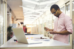 Young teacher and student searching creative solution of traffic jams problem standing in coworking office royalty free stock photography