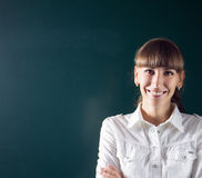 Young teacher or student standing near blackboard Royalty Free Stock Photos