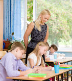 Young teacher supervises the students during the exam Stock Photo
