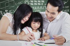 Young teacher teach a child to write Stock Image