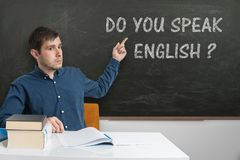 Young teacher is teaching English language at school.  Stock Images