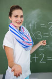 Young teacher teaching mathematics in classroom Royalty Free Stock Images