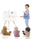 Young Teacher, Tiny Students Stock Images