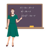 Young teacher woman in costume near the desk on white background. Royalty Free Stock Photo