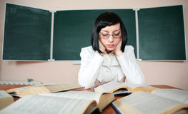 Young teacher woman on green board Royalty Free Stock Photos