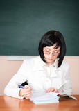 Young teacher woman on green board Stock Photo