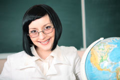 Young teacher woman on green board Royalty Free Stock Photography