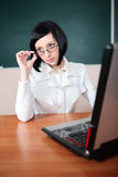 Young teacher woman on green board Stock Photos