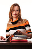 Young teacher woman sitting at the desk Royalty Free Stock Images