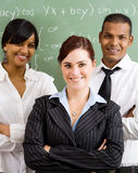 Young teachers. Group of young school teachers in classroom Royalty Free Stock Images