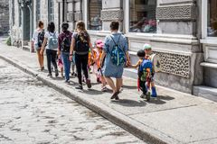 Young teachers walking small children along street Royalty Free Stock Photography